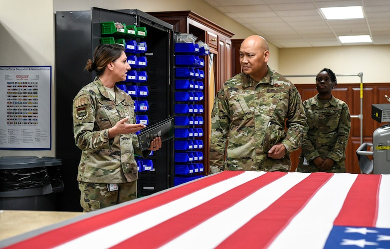 Master Sgt. Holly Roberts-Davis, Air Force Mortuary Affairs Operations public affairs, speaks to Brig. Gen. Jimmy Canlas, 618th Air Operations Center commander, Jan. 24, 2020, at Dover Air Force Base, Del. Roberts-Davis briefed Canlas on how AFMAO provides care, service and support to fallen service members and their families. (U.S. Air Force photo by Senior Airman Christopher Quail)