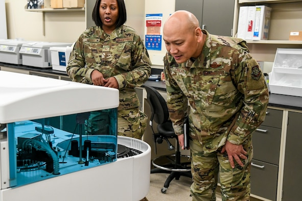 Brig. Gen. Jimmy Canlas, 618th Air Operations Center commander, views Armed Forces Medical Examiner System (AFMES) forensic equipment Jan. 24, 2020, at Dover Air Force Base, Del. Canlas visited AFMES to learn more about their forensic investigative services, to include forensic pathology, DNA forensics, forensic toxicology and medical mortality surveillance. (U.S. Air Force photo by Senior Airman Christopher Quail)