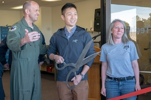 Brig. Gen. E. John Teichert, 412th Test Wing Commander; James M. Wang, program designer and Air Force ROTC student at Stanford University in Palo Alto, Calif.; and Dori Spaulding, command spouse representative for the 412th Operations Group, prepare to launch the TechEd High School Makerspace during a ribbon-cutting ceremony at Edwards Air Force Base, January 29. (Air Force photo by Grady T. Fontana/Released)