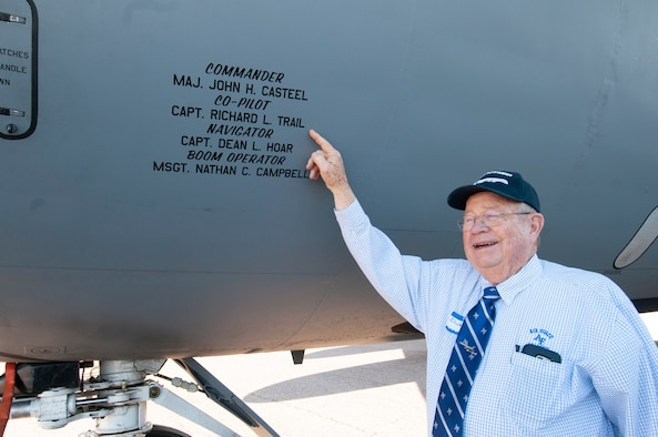 "Retired Lt. Col. Richard ""Dick"" Trail points to the crew members of the 1967 Mackay Trophy award mission inscribed on the nose of KC-135 Stratotanker, tail number 60-0329, Oct. 2, 2019, Colorado Springs, CO."