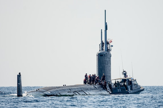 GULF OF TADJOURA (Nov. 5, 2019) A 34-foot Dauntless-class patrol boat assigned to Coastal Riverine Squadron (CRS) 1 transfers supplies to the Virginia-class fast-attack submarine USS Texas (SSN 775) in the Gulf of Tadjoura. CRS-1 is forward-deployed with Combined Task Group 68.6 at Camp Lemonnier, Djibouti.