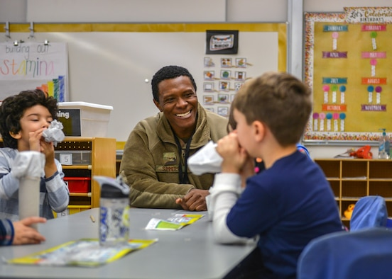 U.S. Air Force Airman 1st Class Dante N. Summers, 606th Air Control Squadron power production technician, teaches students how to make a kazoo during a Science, Technology, Engineering and Math Junk Box Challenge at Aviano Elementary School, Aviano Air Base, Italy, Jan. 28, 2020. Summers volunteered for the STEM event because he was a middle school teacher's aide before he joined the military. (U.S. Air Force photo by Airman Thomas S. Keisler IV)