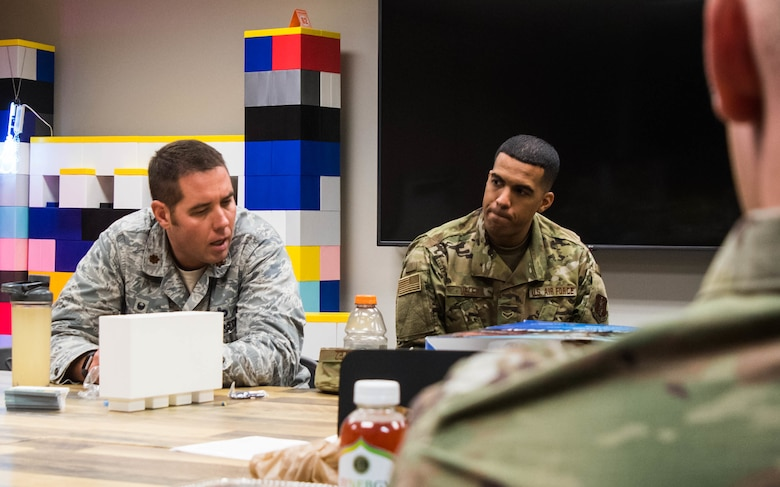 U.S. Air Force Maj. Mathew Joseph, the civil engineering squadron commander assigned to the 136th Airlift Wing, Texas Air National Guard, and A1C Kenneth Velez, the enlisted advisory council president also from the 136th AW, participate in Innovation Brown Bag luncheon to discuss current innovative ideas and recent updates over ongoing projects Oct. 20, 2019, at Naval Air Station Joint Reserve Base Fort Worth, Texas. (U.S. Air National Guard photo by A1C Charissa Menken)