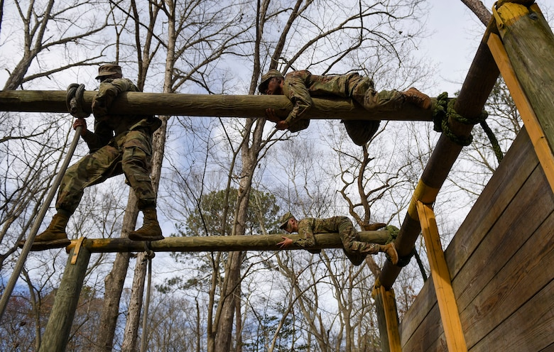 U.S. Army Advanced Individual Training Soldiers maneuver through an obstacle course during a field training exercise at Joint Base Langley-Eustis, Virginia, Jan. 24, 2020.