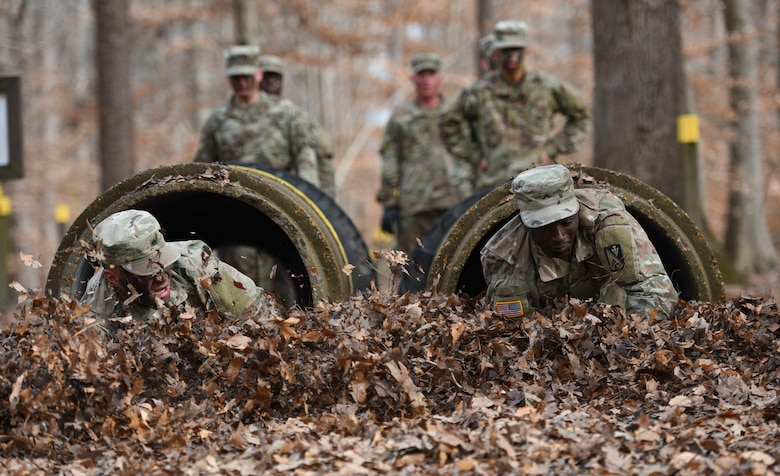 U.S. Army Advanced Individual Training Soldiers crawl through cement pipes during a field training exercise at Joint Base Langley-Eustis, Virginia, Jan. 24, 2020.