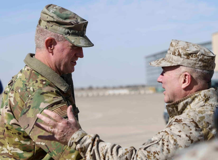 U.S. Air Force Brig. Gen. John C. Walker, left, 378th Air Expeditionary Wing commander, greets U.S. Marine Corps Gen. Kenneth F. McKenzie Jr., right, commander, United States Central Command, at Prince Sultan Air Base, Kingdom of Saudi Arabia, Jan. 29, 2020. The CENTCOM command team's tour of installations in the command's area of responsibility underscores the U.S.'s commitment to regional security, the flexibility of American military power, and the importance of military-to-military relationships with coalition partners. (U.S. Air Force photo by Senior Airman Giovanni Sims)