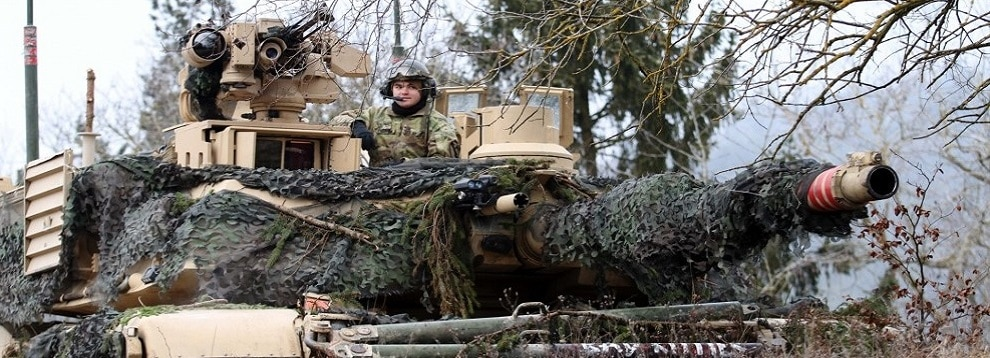 A Soldier remains vigilant from atop his tank during Combined Resolve XIII at The Joint Multinational Readiness Center in Hohenfels, Germany on January 24, 2020. At this training, allied and partner troops practice battle scenarios to hone their skills in a real-world training environment.