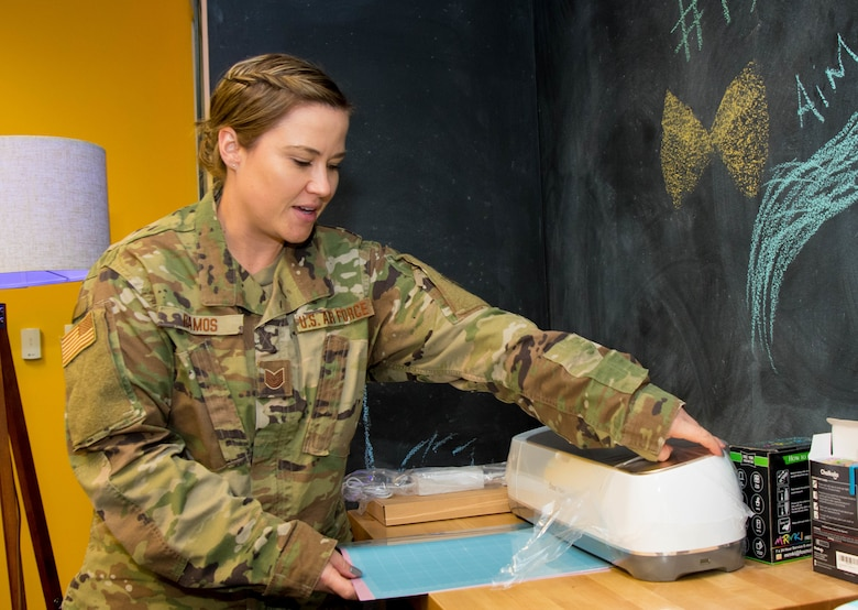 Texas Air National Guard member uses a cricut machine in the 136th Airlift Wing's new Innovation Room.