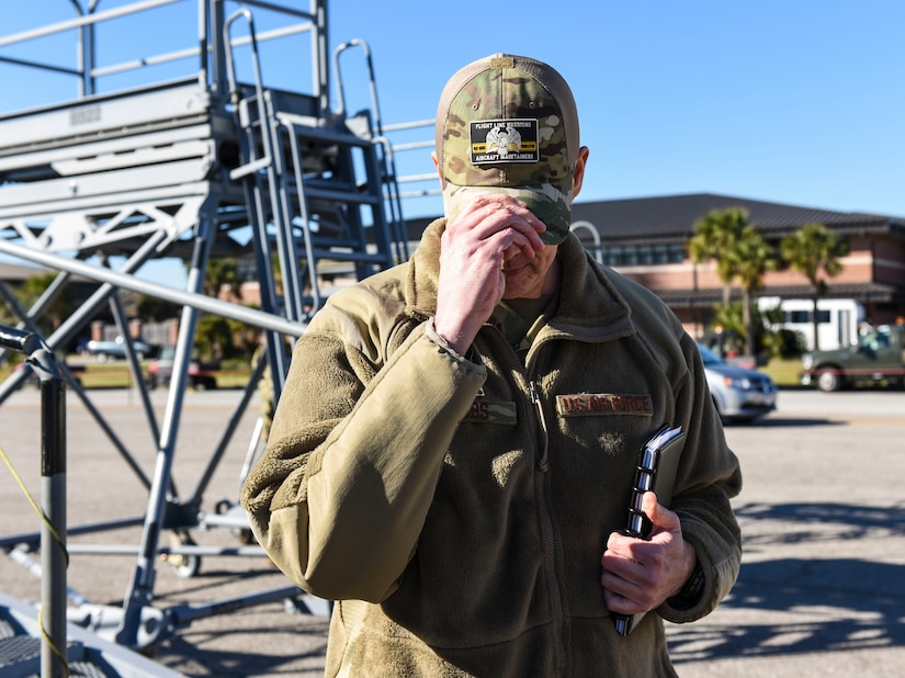 Brig. Gen. Richard W. Gibbs, Air Mobility Command Logistics, Engineering and Force Protection director, dons a cap featuring a flight line warriors aircraft maintainers patch at Joint Base Charleston, S.C., Jan. 28, 2020.