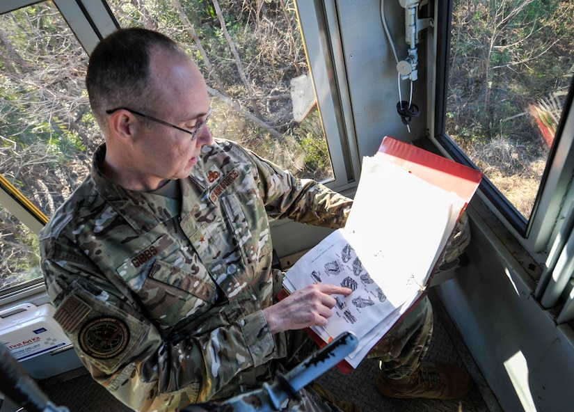 Brig. Gen. Richard W. Gibbs, Air Mobility Command Logistics, Engineering and Force Protection director, examines a locomotive handbook at Joint Base Charleston, S.C., Jan. 28, 2020.