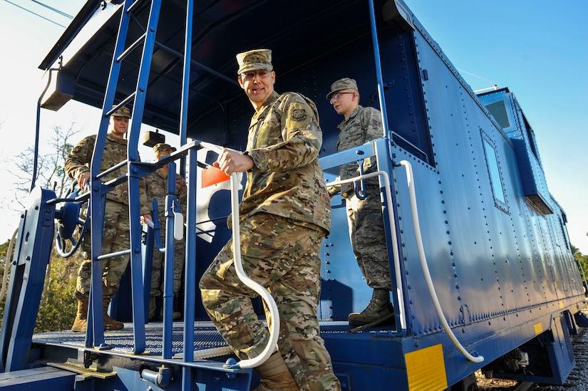 Brig. Gen. Richard W. Gibbs, Air Mobility Command Logistics, Engineering and Force Protection director, steps onto a train at Joint Base Charleston, S.C., Jan. 28, 2020.