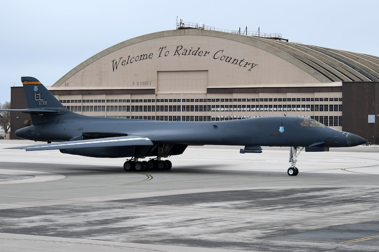 A B-1B Lancer assigned to the 28th Bomb Wing taxi's past the PRIDE Hangar at Ellsworth Air Force Base, S.D., Jan. 22, 2020. The 37th Bomb Squadron is participating in Red Flag 20-1, where its mission is to maximize the combat readiness and survivability of participants by providing multi-domain training in a combined threat environment. (U.S. Air Force photo by Staff Sgt. Hailey Staker)