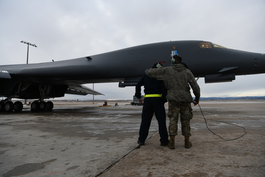Two 37th Bomb Squadron crew chiefs work together to prepare a B-1B Lancer for Red Flag 20-1 at Ellsworth Air Force Base, S.D., Jan. 22, 2020. Each year, four to six Red Flag exercises are held at Nellis Air Force Base, Nev. (U.S. Air Force photo by Senior Airman Nicolas Z. Erwin)