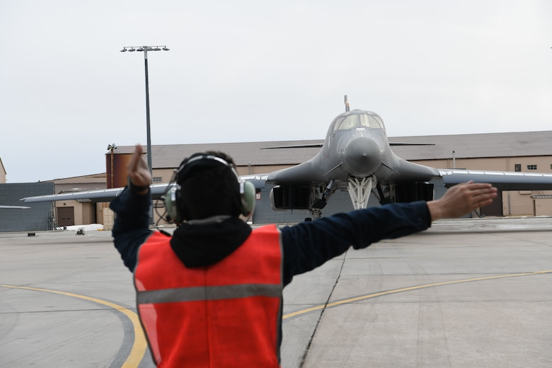 Airman Jacob Martinez, a 37th Bomb Squadron crew chief, ushers a B-1B Lancer at Ellsworth Air Force Base, S.D., Jan. 22, 2020. Red Flag is the U.S. Air Force's premier air-to-air combat training exercise. (U.S. Air Force photo by Senior Airman Nicolas Z. Erwin)