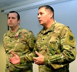 Lt. Col. Darren Horton, Commander, Recruiting and Retention Battalion, Illinois National Guard, highlights the work of Sgt. 1st Class Matthew P. Harris, of Petersburg, Illinois, to increase the RBB's efficiency and strategic alignment.