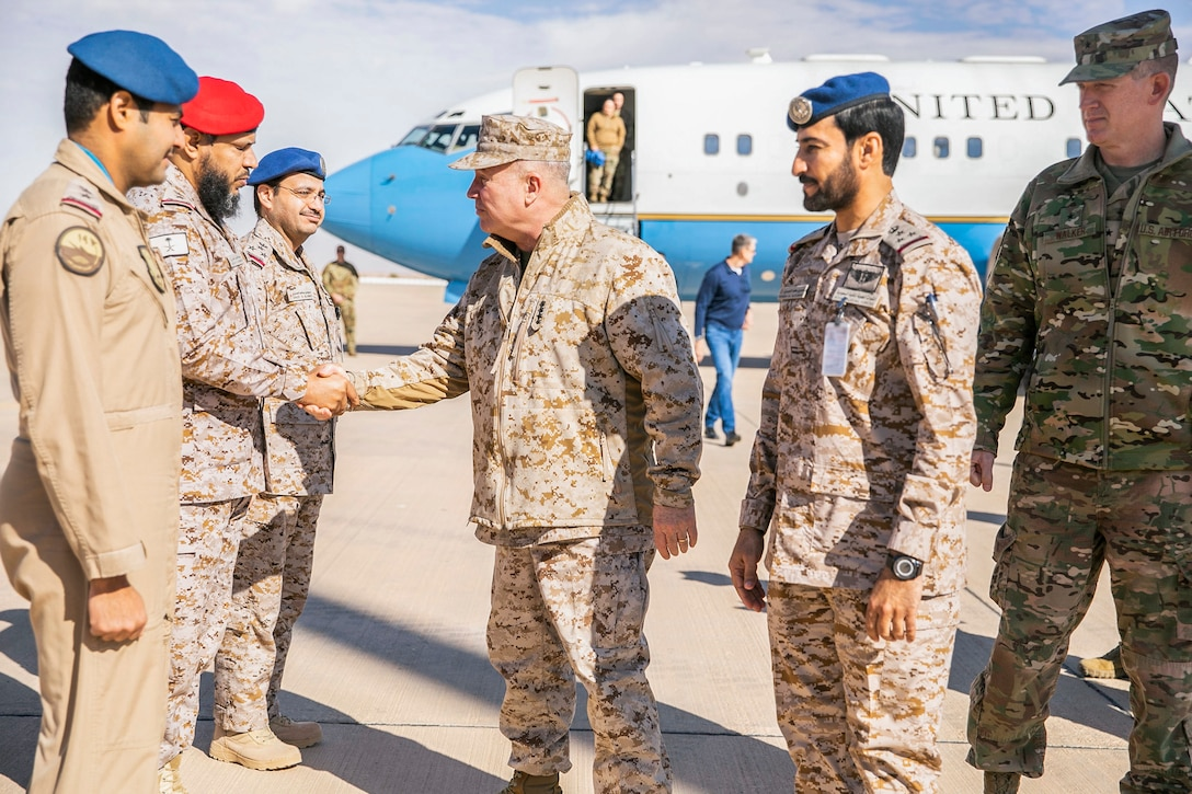U.S. Marine Corps Gen. Kenneth F. McKenzie Jr., the commander of U.S. Central Command, center, greets Royal Saudi Air Force service members, Jan. 29, 2020. (U.S. Marine Corps photo by Sgt. Roderick Jacquote)