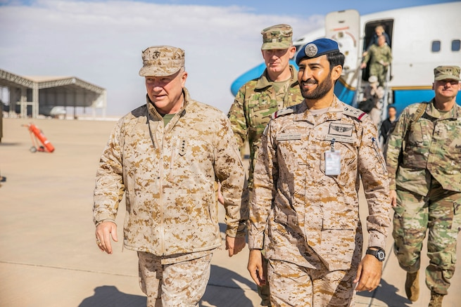 U.S. Marine Corps Gen. Kenneth F. McKenzie Jr., the commander of U.S. Central Command, left, meets with Brig. Gen. Nasser Mohammed Al-Dossari, the Royal Saudi Air Force Operations Support Wing Commander, right, Jan. 29, 2019. (U.S. Marine Corps photo by Sgt. Roderick Jacquote)