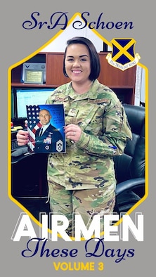 Senior Airman Jordyn Schoen holds the official photo of 37th Training Wing Command Chief, Chief Master Sgt. Stefan Blazier to motivate her to one day become a command chief herself.