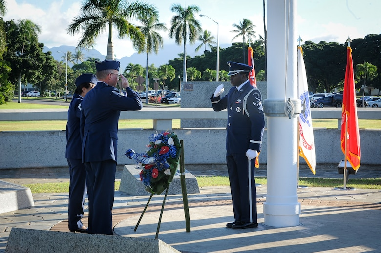 Col. Dann S. Carlson, 154th Wing commander, and Chief Master Sgt. Carol Orr, 154th Wing Command Chief, lay a wreath on behalf of the men and women of Pacific Air Forces at the flag pole during the Hickam Field Dec. 7th Remembrance Ceremony at Atterbury Circle, Joint Base Pearl Harbor-Hickam, Hawaii, Dec. 7, 2019.
