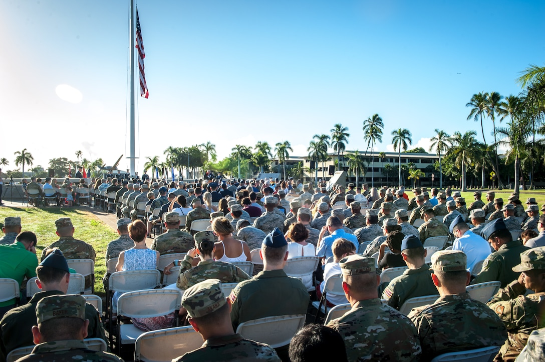Airmen from the 15th and 154th Wings, family members and honored guests observe the Hickam Field Dec. 7th Remembrance Ceremony at Atterbury Circle, Joint Base Pearl Harbor-Hickam, Hawaii, Dec. 7, 2019. More than 100 military members, veterans and family members attended the ceremony to honor and remember the Airmen who lost their lives during the two waves of attacks by Japan on Dec. 7, 1941