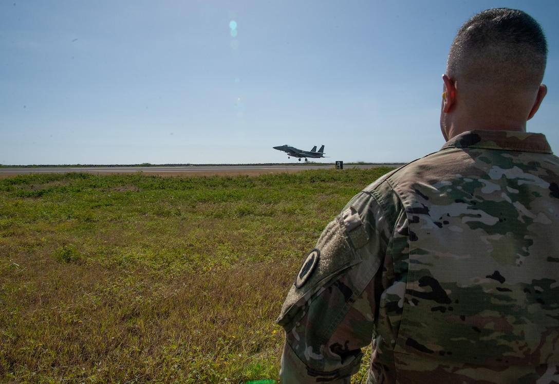 The Adjutant General of Hawaii, Maj. Gen. Kenneth S. Hara, watches as a Hawaii F-22 Raptor takes off on the Joint Base Pearl Harbor-Hickam runway, January 21, 2020.
