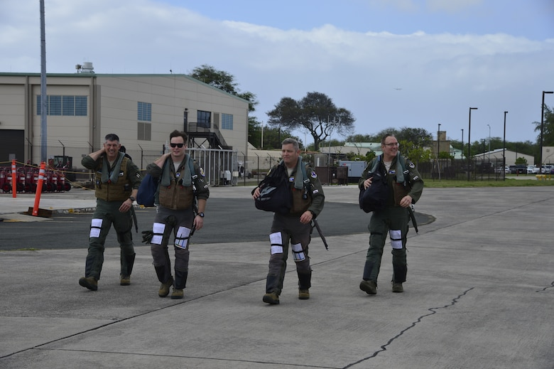 194th Fighter Squadron pilots from California Air National Guard's 144th Fighter Wing step to their F-15 Eagle fighter jets for the afternoon mission at Joint Base Pearl Harbor-Hickam, Hawaii during Sentry Aloha 20-01 Jan. 08, 2020.