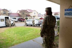 Master Sgt. Erica Brown, from the 42nd Medical Support Squadron, waits as her husband, Master Sgt. Brian Brown, from the 26th Network Operation Squadron, greets Lt. Gen. Marshall B. Webb, commander of Air Education and Training Command, upon arriving to their home Jan. 29, 2020, on Maxwell Air Force Base, Alabama. The AETC command team toured the Brown's house in privatized housing, along with other houses and the dormitories, to speak with residents and understand the issues affecting Airmen's quality of life. (U.S. Air Force photo by Senior Airman Alexa Culbert)