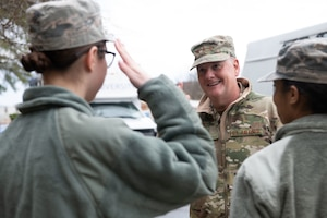 Lt. Gen. Marshall B. Webb, commander of Air Education and Training Command, returns a salute from a junior enlisted Airman while visiting the base dorms, Jan. 29, 2020, on Maxwell Air Force Base, Alabama. Webb, along with the leadership from Air University and the 42nd Air Base Wing toured the base dorms, including the rooms of Airmen in training and permanently stationed here, in order to understand and address housing concerns. (U.S. Air Force photo by Senior Airman Alexa Culbert)