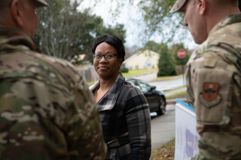 Kaneshia Pickens, dorm manager, speaks with the command teams from Air Education and Training Command, Air University and the 42nd Air Base Wing during their arrival to tour the dorms, Jan. 29, 2020 at Maxwell Air Force Base, Alabama. During their visit, the command teams toured the rooms of two Airmen and other dorm amenities. (U.S. Air Force photo by Senior Airman Alexa Culbert)