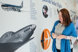 Dawna Webb, spouse of Lt. Gen. Brad Webb, commander of Air Education and Training Command, takes a closer look at a mural depicting the timeline of airpower while touring the new Maxwell Elementary Middle School Jan. 29, 2020 on Maxwell Air Force Base, Alabama. Webb was also accompanied by the spouses of Air University and 42nd Air Base Wing senior leaders. The group viewed the school's recent renovations and progress made to improve public education options for military-connected children. (US Air Force photo by Melanie Rodgers Cox)