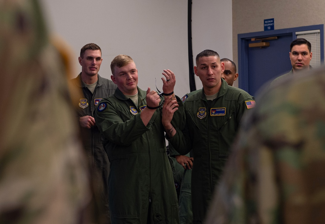 Master Sgt. Joseph Sorreno, 627th Security Forces Squadron Phoenix Ravens program manager, middle right, demonstrates how to handcuff a detainee during an instructive course at Joint Base Lewis-McChord, Wash., Dec. 5, 2019. Sorreno and other Raven Airmen taught a class to Soldiers assigned to 595th Military Police Company, 508th Military Police Battalion, on how to process and hold detainees. (U.S. Air Force photo by Senior Airman Tryphena Mayhugh)