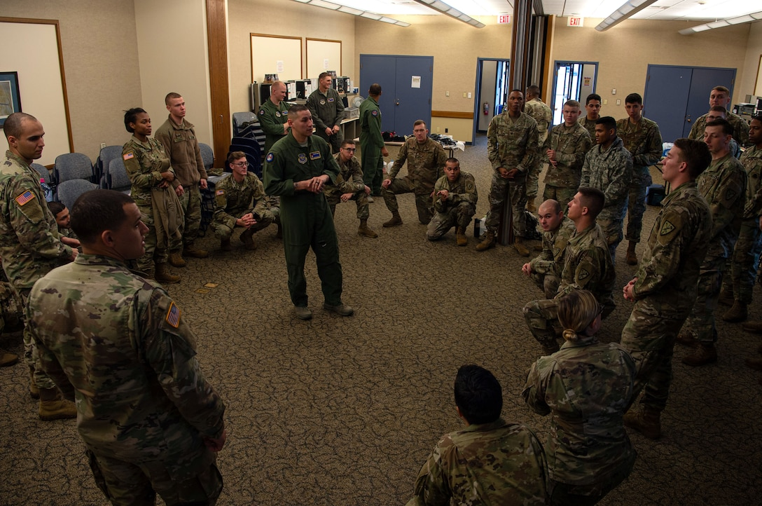 Master Sgt. Joseph Sorreno, 627th Security Forces Squadron Phoenix Ravens program manager, teaches a course on how to process and hold detainees to 595th Military Police Company, 508th Military Police Battalion Soldiers at Joint Base Lewis-McChord, Wash., Dec. 5, 2019. The Soldiers are deploying and their battalion decided to use the Air Force to cross train and see how the Air Force load and unload detainees. (U.S. Air Force photo by Senior Airman Tryphena Mayhugh)