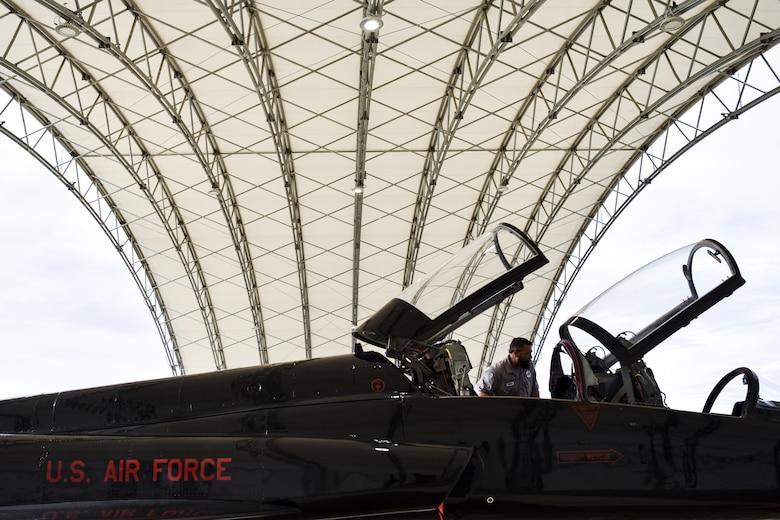 T-38 Talon mechanic works on aircraft
