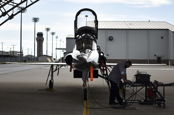 T-38 Talon mechanic works on aircraft