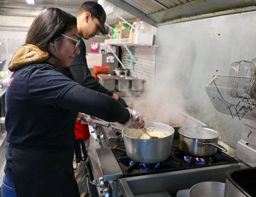 Nayely Vasquez-Sauceda and Sgt. Joshua Vasquez-Sauceda, wheeled vehicle mechanic, 1st Theater Sustainment Command, prepare food while working in their food truck, Papi's Tacos & More, in Radcliff, Ky., on Jan. 23, 2020. Vasquez-Sauceda is currently on terminal leave and will complete his enlistment in the Army on Feb. 19, 2020