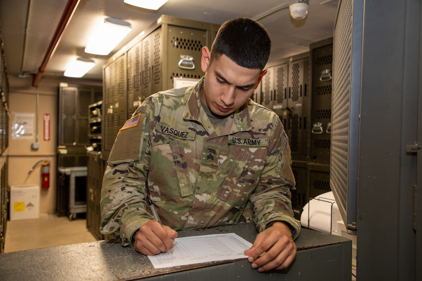 Sgt. Joshua Vasquez-Sauceda, wheeled vehicle mechanic, 1st Theater Sustainment Command, fills out a form at the 1st TSC armory on Fort Knox, Ky., on Jan. 15, 2020. Vasquez-Sauceda will complete his enlistment in the Army on Feb. 19, 2020. He is the owner of Papi's Tacos & More, a food truck which operates in the Fort Knox area.