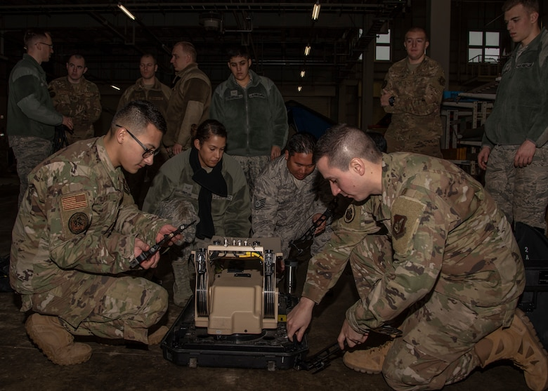 Airmen from the 35th Fighter Wing disassemble a communication flyaway kit at Misawa Air Base, Japan, Jan. 29, 2020. The CFK is a network used to connect to a satellite to help provide people with communications wherever they are. Multi-Domain Airman training encompasses the necessary skills, knowledge and experience to successfully generate combat power in an austere and expeditionary battlespace. (U.S. Air Force photo by Airman 1st Class China M. Shock)