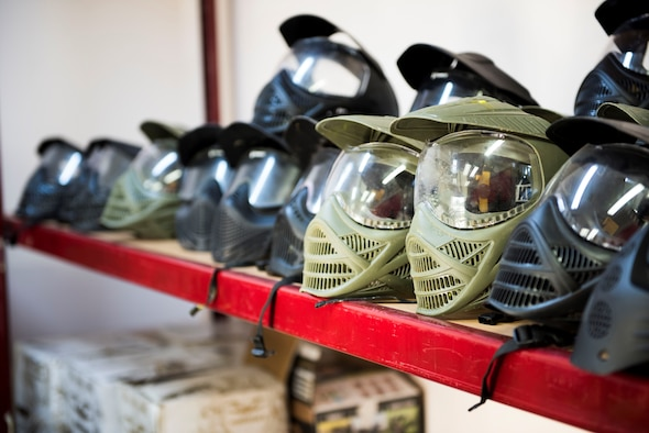Paintball helmets sit on display at the Outdoor Recreation Center