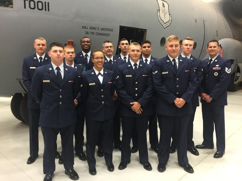 Then U.S. Air Force Tech. Sgt. Hollie McCaleb (far right) Air Education and Training Command instructor, poses for a photo with his class at Sheppard Air Force Base, Texas on May 23, 2016. McCaleb taught over 900 students about maintenance processes.