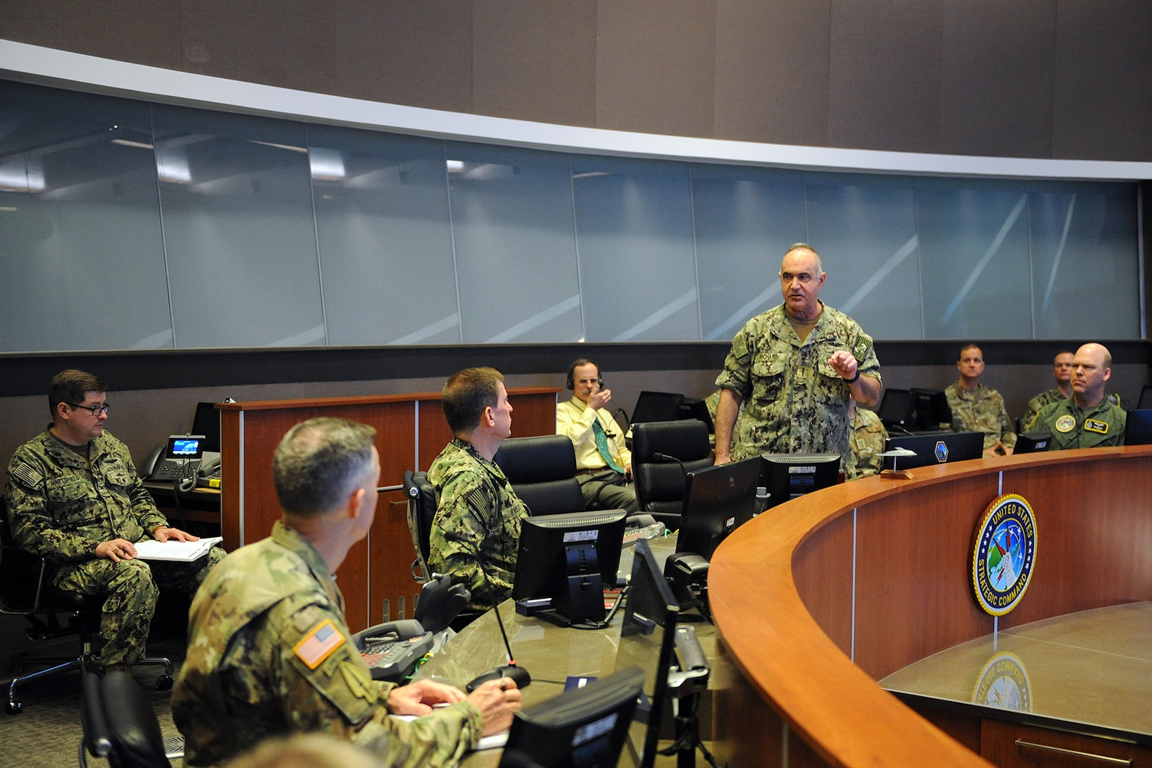 "U.S. Navy Adm. Charles ""Chas"" Richard, commander of U.S. Strategic Command (USSTRATCOM), speaks to his key staff on the battle deck of USSTRATCOM's command and control facility (C2F) during Exercise Global Lightning 20 at Offutt Air Force Base, Neb., Jan. 30, 2020. Global Lightning 20 tested executing global operations in coordination with the Joint Staff, 5 other combatant commands, services, U.S. government agencies, and allies to deter, detect and, if necessary, defeat strategic attacks against the United States and its allies. This is the first major exercise USSTRATCOM conducted entirely from the C2F, the command's newest weapon system that enables it to connect to national leadership, all three legs of the triad, and other platforms key to executing operations."