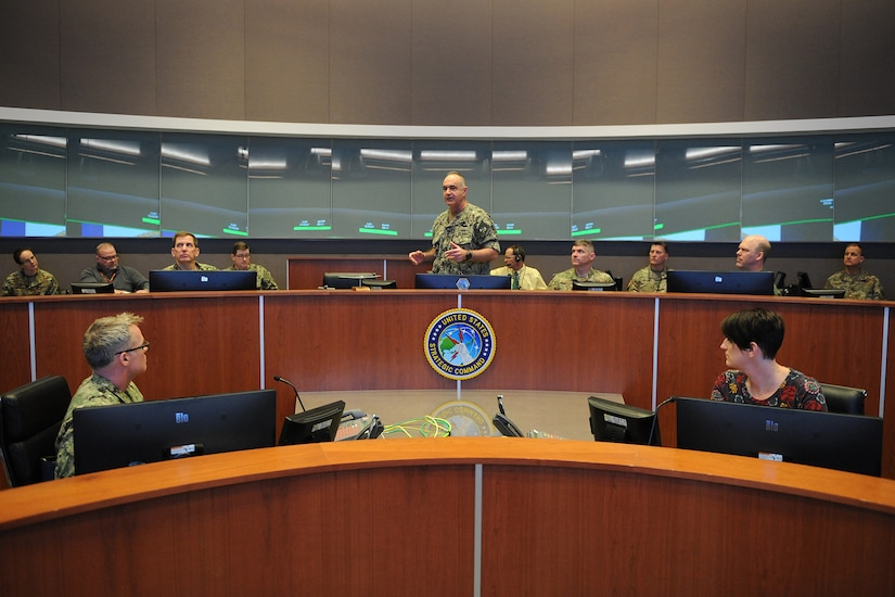 "U.S. Navy Adm. Charles ""Chas"" Richard, commander of U.S. Strategic Command (USSTRATCOM), speaks to his key staff on the battle deck of USSTRATCOM's command and control facility (C2F) during Exercise Global Lightning 20 at Offutt Air Force Base, Neb., Jan. 30, 2020. Global Lightning is an annual command and control exercise that employs global operations in coordination with other combatant commands, services, U.S. government agencies, and allies to deter, detect and, if necessary, defeat strategic attacks against the United States and its allies. This is the first major exercise USSTRATCOM conducted entirely from the C2F, the command's newest weapon system that enables it to connect to national leadership, all three legs of the triad, and other platforms key to executing operations."