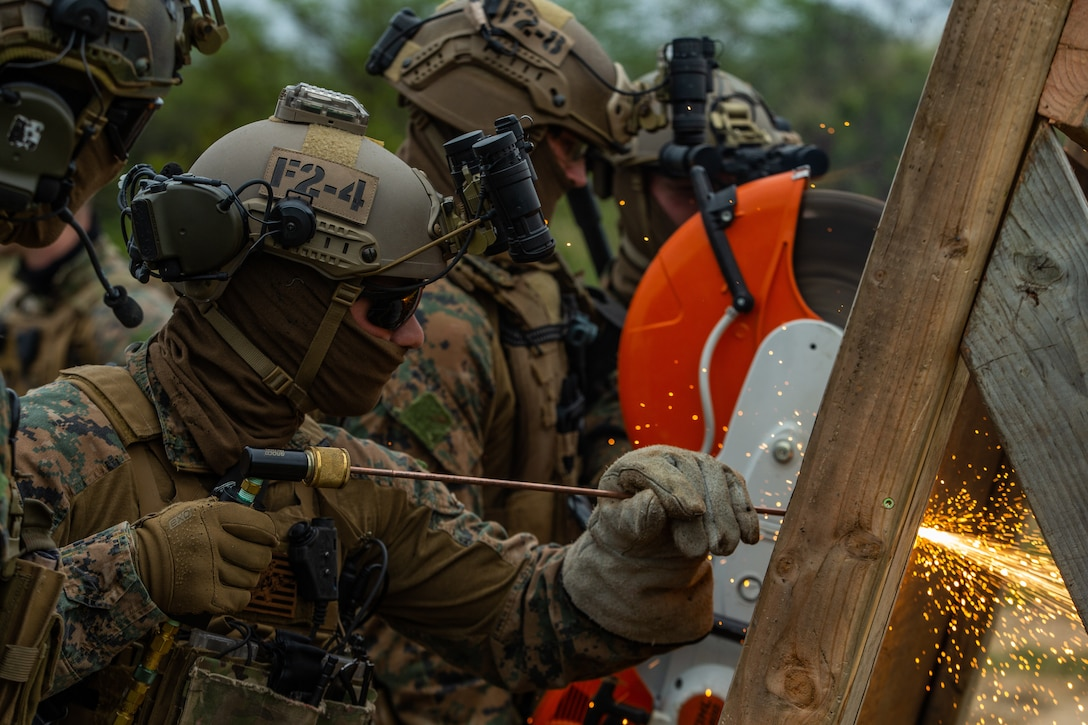U.S. Marines breach a simulated entrance during Visit, Board, Search and Seizure training in Iroquois Point, Hawaii, Jan. 13.