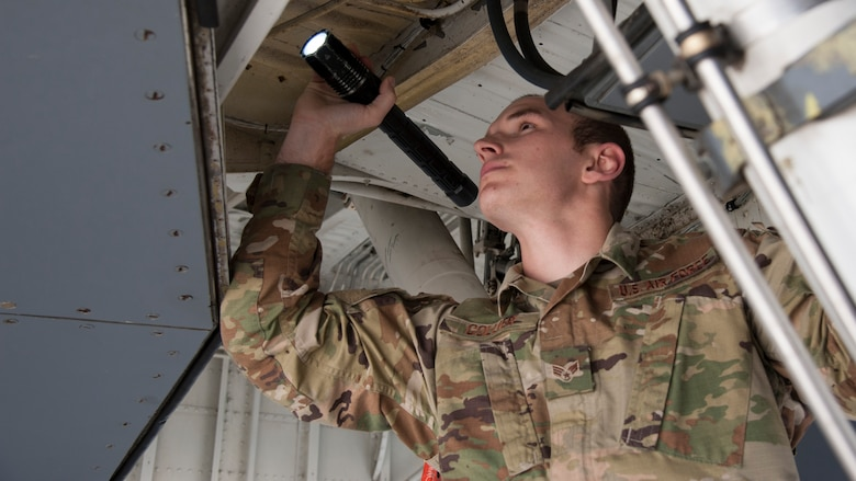 U.S. Air Force Senior Airman Clayton Collier, a 6th Aircraft Maintenance Squadron (AMXS) crew chief, inspects landing gear systems on a KC-135 Stratotanker, Jan. 23, 2020, at MacDill Crew chiefs assigned to the 6th AMXS perform aircraft maintenance and conduct inspections and servicing to ensure the KC-135 accomplishes its primary mission of global reach.