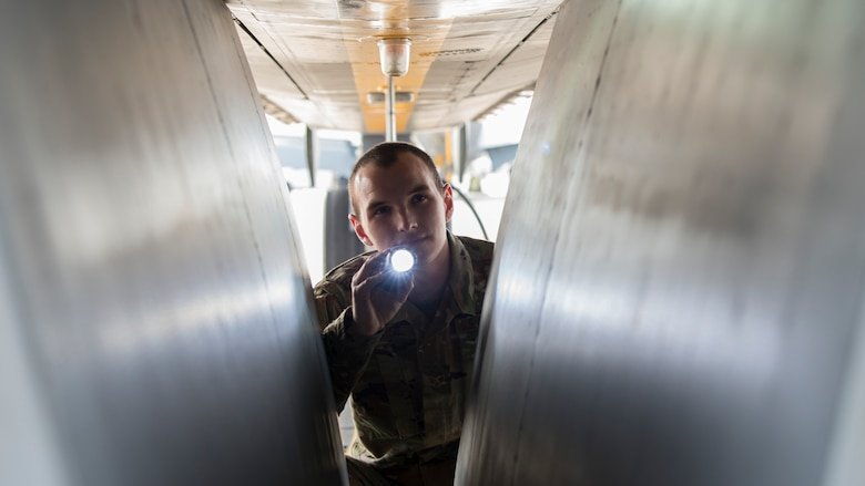 U.S. Air Force Senior Airman Clayton Collier, a 6th Aircraft Maintenance Squadron (AMXS) crew chief, inspects landing gear systems, on a KC-135 Stratotanker, Jan. 23, 2020, at MacDill Air Force Base, Fla. In 2019, the 6th AMXS supported over 5,000 flight hours and 965 sorties.