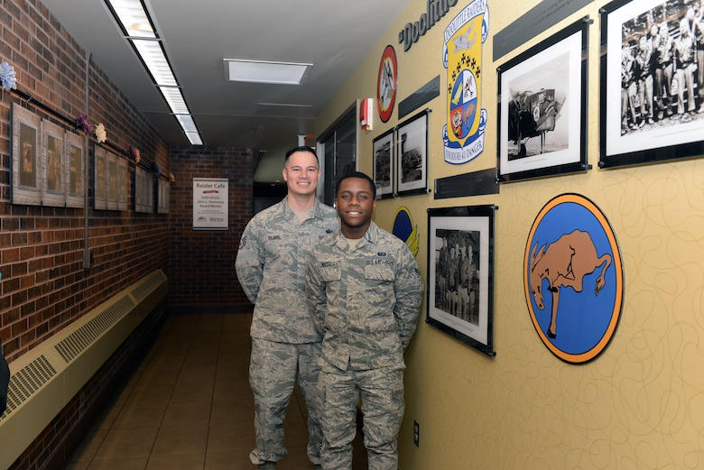 Staff Sgt. Jan Vincent Pilapil, the 28th Force Support Squadron training and production manager, at the Raider Café and Airman 1st Class Jalen Mackall, a 28th FSS Food Services journeyman, pose for a photo at Ellsworth Air Force Base, S.D., Jan. 24, 2020. Pilapil and Mackall proposed the idea of the Doolittle Raiders Memorial, as well as the B-1B Lancer Crash Site Memorial. (U.S. Air Force photo by Airman Quentin K. Marx)