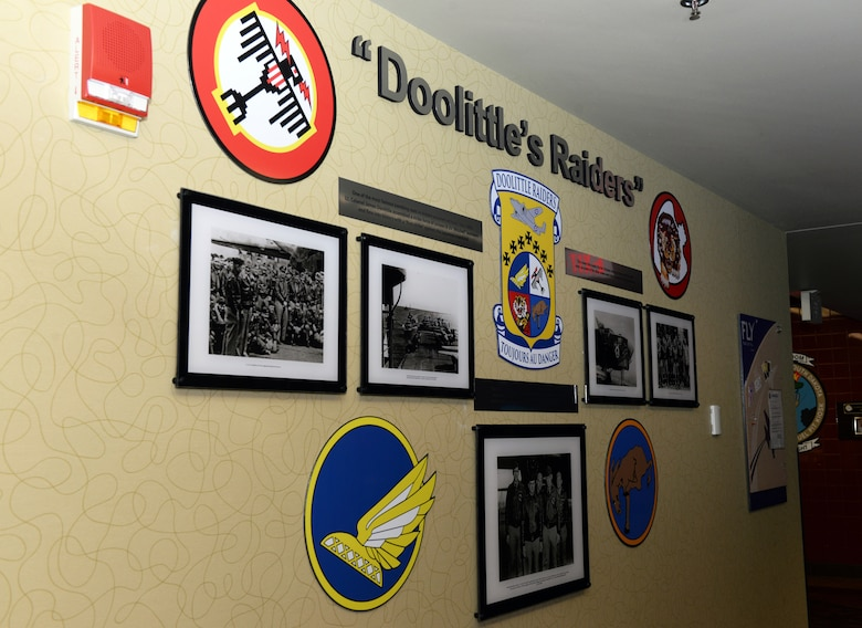 "The Doolittle Raiders Memorial is revealed at the Raider Café at Ellsworth Air Force Base, S.D., Jan. 24, 2020. The memorial shows pictures of Lt. Col. James ""Jimmy"" Doolittle and his squadron with the aircraft, the B-25 ""Mitchell,"" used during the April, 1942 Doolittle Raid, a brief description of the pictures and the four squadrons' patches that were responsible for the raid. (U.S. Air Force photo by Airman Quentin K. Marx)"