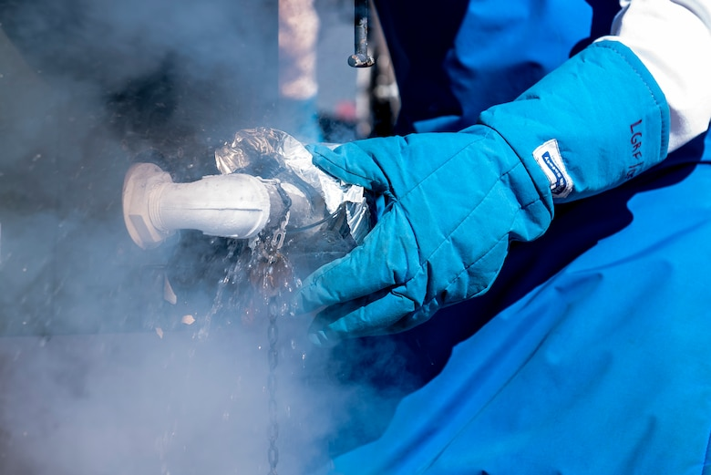 Airman 1st Class Daniel Sage, 27th Special Operations Logistics Readiness Squadron fuels facilities technician, collects a sample of liquid oxygen while filling a tank at Cannon Air Force Base, New Mexico, Jan. 30, 2020. To ensure the safety of those breathing the oxygen, tests are run to ensure the oxygen maintains 99.5% purity. (U.S. Air Force photo by Senior Airman Vernon R. Walter III)