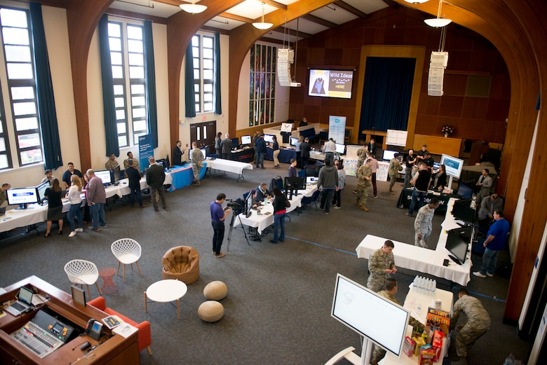 A photograph of a room filled with members gathering during an expo at AFPC's inaugural Innovation Symposium