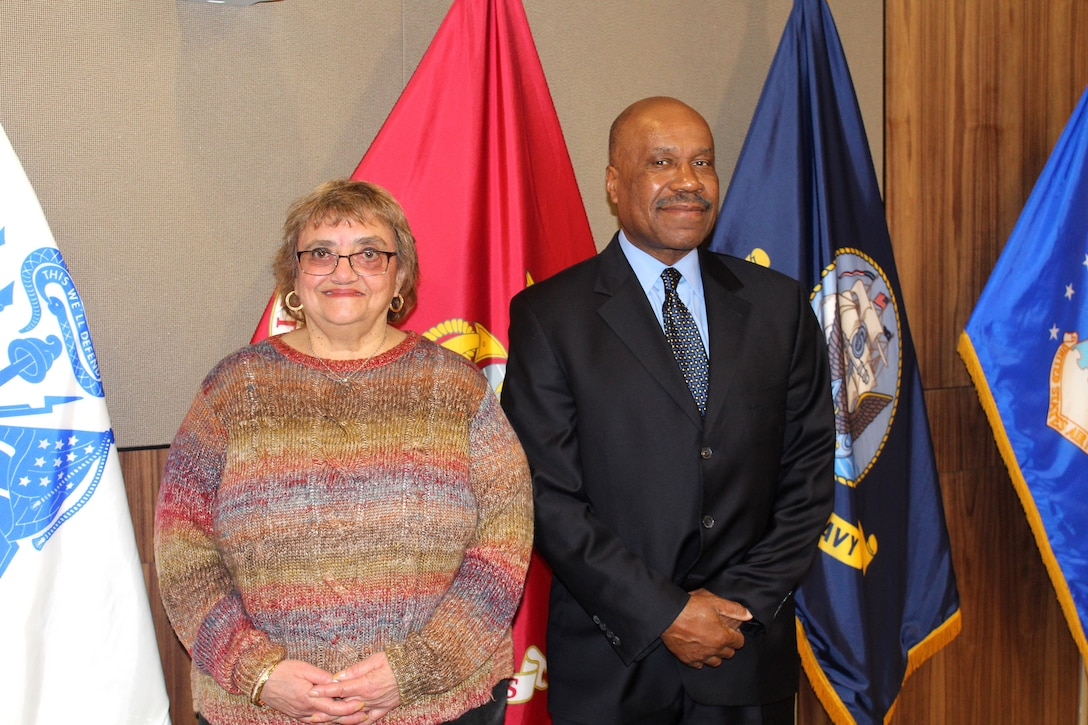 Two civilian retirees at Defense Logistics Agency Troop Support are pictured.