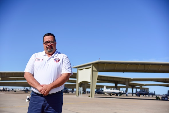 "Steve Hogan, 47th Maintenance T-1A Jayhawk phase supervisor, looks forward to March 14, 2020, a special Saturday here at Laughlin Air Force Base, Texas, the day of the bases' first airshow of the decade. Hogan, a military brat, shares there's something about planes he's always loved. ""My father was an aircraft mechanic for the U.S. Air Force, and I followed his footsteps,"" Hogan said. (U.S. Air Force photo by Senior Airman Anne McCready)"